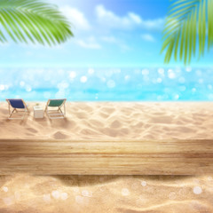 Fototapete - Wooden table top montage with Summer sandy beach  blurred sea view and beach chair summer relaxation background concept