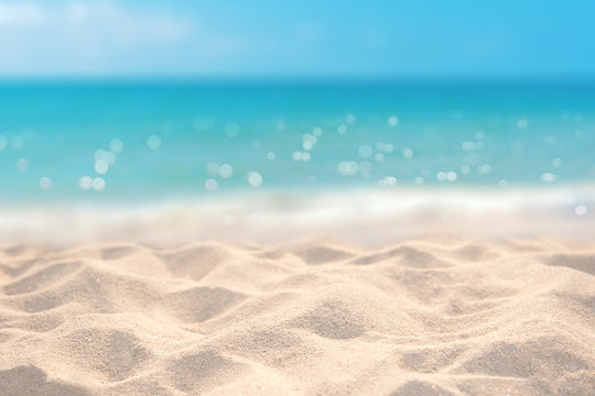 Sand with blurred tropical sandy beach bokeh background, Summer vacation and product advertisment concept