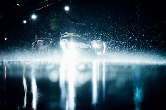 Racecar At Pit Stop During Rain At Night