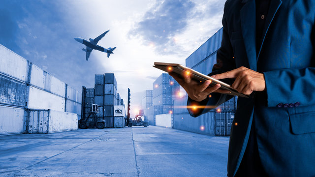 Businessman manager using tablet check and control for workers with Modern Trade warehouse logistics. Industry 5.0 Logistic and transport, Global logistic or world of logistic concept.