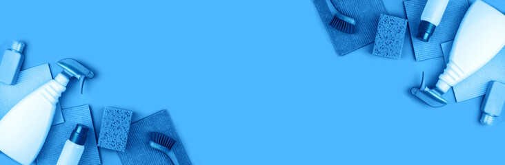 Banner made from cleaning products are on blue background.