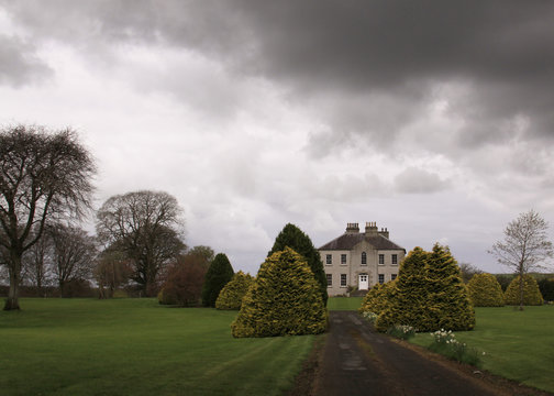 Haunted castle in Ireland with dark clouds