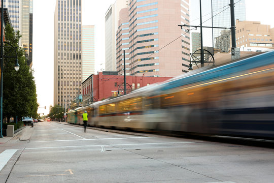 Denver Downtown at Early Morning. Photo Shows Rail Train Running on California Street, Denver Colorado.