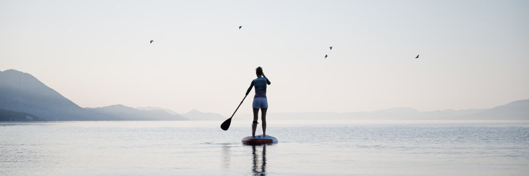 Woman paddling on sup board