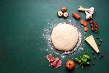 Pizza ingredients and raw dough on table. Making pizza concept