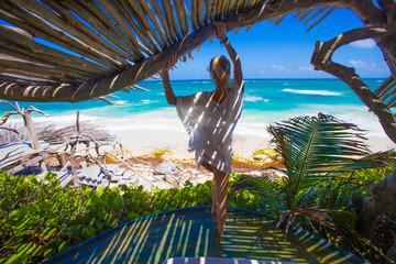 Woman in Shade at a Tropical Beach