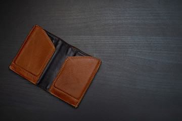 empty wallet on the dark wooden table