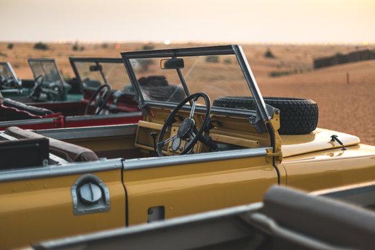 Multiple old Land Rover in the desert of Dubai - UAE