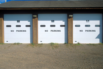 Wall Mural - No Parking signs on a garage door