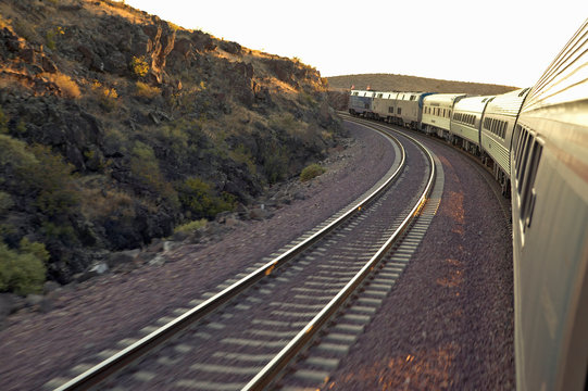 Passenger train traveling into the Arizona sunset