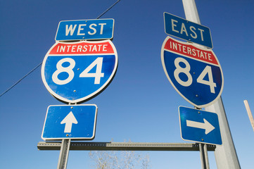 Wall Mural - Interstate highway signs for East and West on Interstate Highway 84
