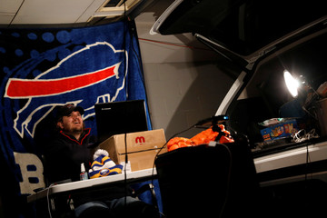 Matt Kabel, Co-founder of New York City Buffalo Bills Backers, participates in the NFL Draft fan inner circle in his garage in the Brooklyn, New York