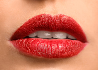 Wall Mural - Young woman with bright lipstick, closeup
