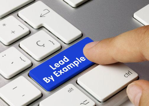 Lead By Example - Inscription on Blue Keyboard Key.