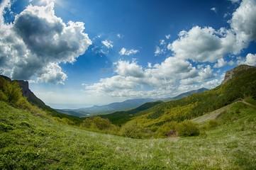 Foto auf Gartenposter Dunkelgrau View Of Countryside Landscape Against Cloudy Sky