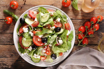 Wall Mural - vegetable salad with tomato, cucumber, cheese and olive