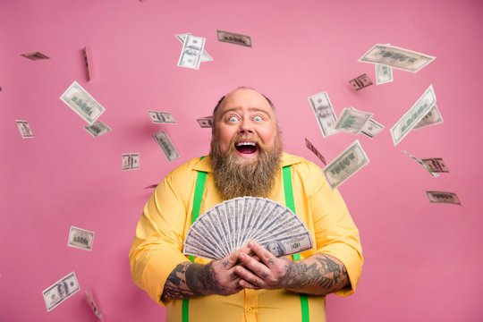 Close-up portrait of his he nice cheerful cheery wealthy bearded guy holding in hands bunch income subsidy donation usd for new life isolated over pink pastel color background