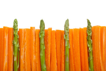 Fence made of carrot sticks and asparagus isolated on white background;