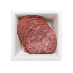 Slices of beef salami in a square bowl isolated on white background; ;