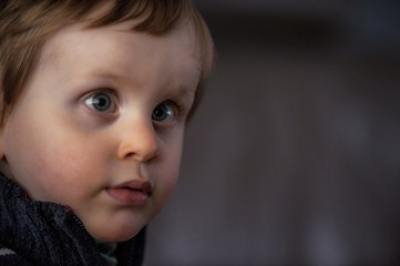 Close-up Portrait Of Cute Boy With Cross-eyed Outdoors