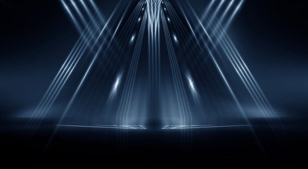Wall Mural - Dark empty abstract scene, rays of searchlights, neon blue light, highlights and lights. Night view of the scene, a tunnel with illumination. Dark background with spotlights.