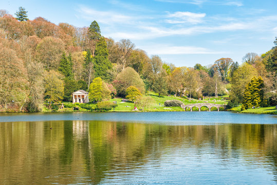 Beautiful Country Park with Stone Bridge and Lake