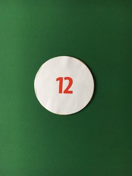 High Angle View Of Number 12 On Green Table