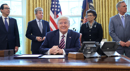 U.S. President Trump participates in coronavirus relief bill signing ceremony at the White House in Washington