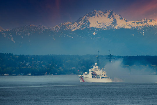 2020-04-22 A LARGE BOAT EMITTING SMOKE IN THE PUGET SOUND WITH MT RAINIER IN THE BACK GROUND NEAR SEATTLE