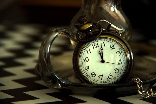 Vintage clock on black background