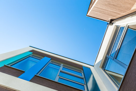 Low Angle View Of A Building Against Clear Blue Sky