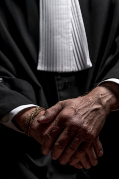 Midsection Of Lawyer Standing Against Black Background