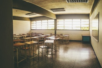 Empty Chairs And Desks In Classroom