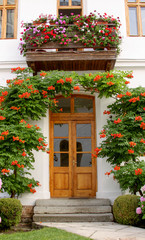 Door entry into house from garden with flowers
