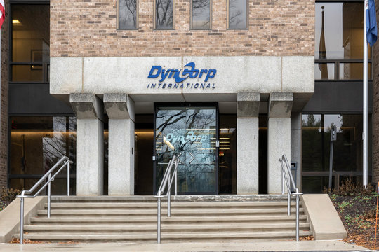 McLean, Virginia, USA - January 14, 2020: Entrance to DynCorp International headquarters building in McLean, Virginia, USA. DynCorp International is an American global service provider.