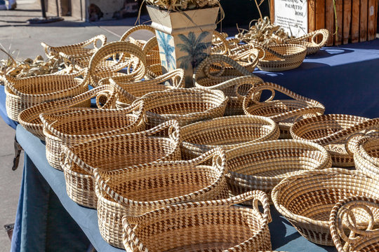 Sweetgrass Baskets,  beautiful handicrafts of African origin, on display at historic Charleston City Market in Charleston, South Carolina.