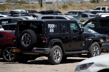 The vehicle of a U.S. citizen who was gunned down along his Mexican girlfriend by unknown assailants is pictured at a car pound of the Chihuahua Attorney General's office in Ciudad Juarez
