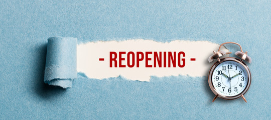 torn paper revealing the word REOPENING on white background