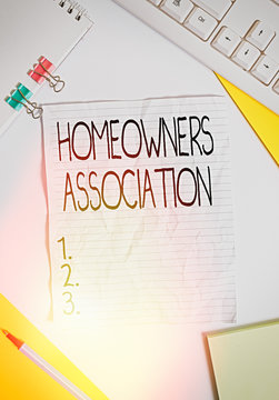 Writing note showing Homeowners Association. Business concept for Organization with fee for upkeeps of Gated Community Colored paper different sizes binder clip sheets white desk empty space