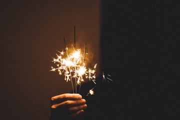 Cropped Image Of Person Holding Sparkler