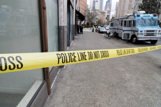 Close-up Of Cordon Tape With Text On Street In City