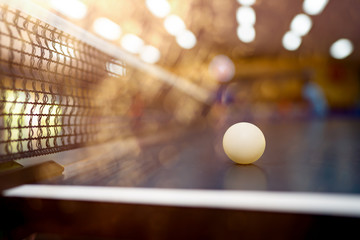 Table tennis ball on table on blurred background for player indoor