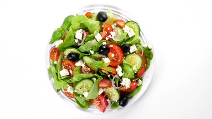 Fotobehang - vegetable salad with cucumber, tomato, olive and feta cheese isolated on white background