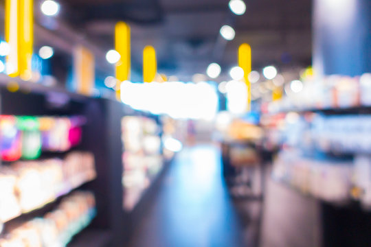 Defocused Image Of Shelves In Illuminated Store At Night