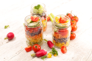 Wall Mural - rainbow vegetable salad in jar and ingredient