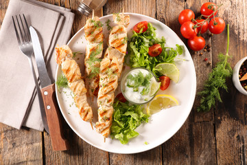Wall Mural - grilled chicken skewer with lettuce and sauce