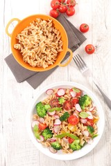 Wall Mural - pasta salad with broccoli, radish and tomato