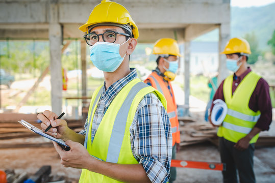 A team of construction engineers and three architects are ready to wear medical masks. Corona or Covid-19 wear masks during the design of construction.