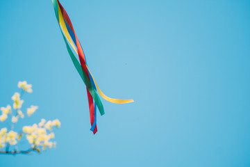 Close-up Of Multi Colored Ribbons Against Sky