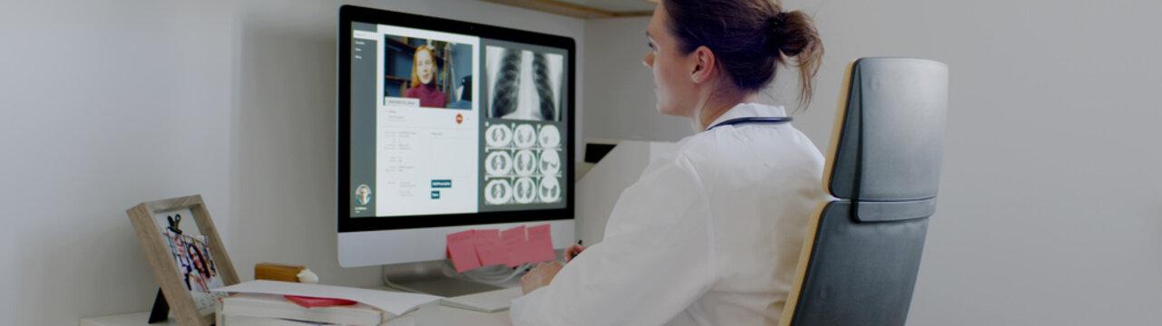 Caucasian female doctor delivering telemedicine consultation to a patient. Telehealth, telemedicine, remote consultation service. Coronavirus, COVID-19
